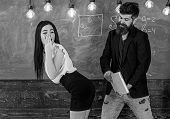 Man With Beard Slapping Sexy Student, Chalkboard On Background. Girl On Guilty And Helpless Face Pun poster