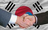Businessmen Handshake After Good Deal In Front Of South Korea Flag