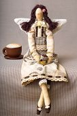 stock photo of tilde  - tilde toy handmade coffee girl and a cup of coffee - JPG