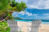 Beach Chairs On Beautiful Sandy Beach With Palm And Turquoise Sea On Jamaica Paradise Island. Summer poster
