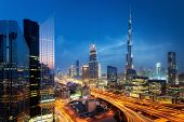 Beautiful Aerial View To Dubai Downtown City Center Lights Skyline At Night, United Arab Emirates. L poster