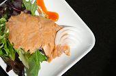 Alaskan Smoked Sockeye Salmon Starter On A Bed Of Lettuce