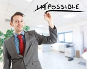Business concept: motivation. Word impossible transformed into possible.