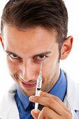 Doctor preparing a syringe