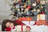 Little Child Girl Likes Xmas Present. Christmas. Kid Enjoy The Holiday. Happy New Year. Small Sleepy poster