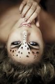 Image of luxury girl, like a leopard