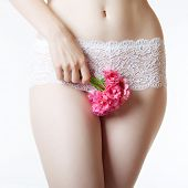 picture of menstruation  - The image of the female abdomen and thighs with a bunch of flowers - JPG