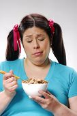 stock photo of fat woman  - Fat woman holding a cereal bowl - JPG