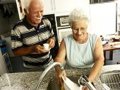 image of coexist  - grandparents in a kitchen - JPG