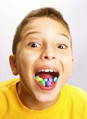Little boy eating candy on white background. Little boy eating chicle.