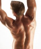 picture of jive  - Shaped and young man stretching his muscles - JPG