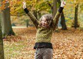 Happy Teenager Girl In Autumn Park