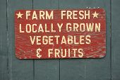 stock photo of farmers  - FARM FRESH vegtables and fruits sign at farmers market - JPG