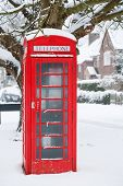 stock photo of pinner  - Traditional English phone box in an English village - JPG