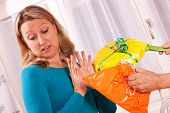 stock photo of pissed off  - pretty young woman is pissed off bad gifts - JPG