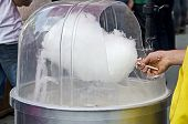 stock photo of candy cotton  - Process of making cotton candy close up - JPG