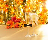 stock photo of hetero  - Champagne glasses with conceptual heterosexual decoration for straight couples - JPG