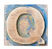 Wooden alphabet block, letter Q