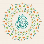 Arabic Islamic calligraphy of text Ramadan Kareem on floral beautiful floral decorated background.