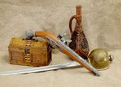 picture of rapier  - Still life with bottle rapier sword pistol and chest - JPG