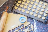 Wooden Rolling Pin, Raw Dough And Heart Shaped Cookie Cutter