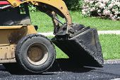 Skid loader with asphalt