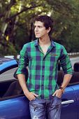 Handsome Man With Casual Clothes Posing Near His Car, Outdoors Portrait