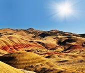 The Painted Hills and Sun at background