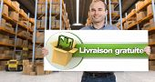 A man holding a Livraison gratuite board, meaning free delivery in French,  in a distribution wareh