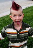 stock photo of adverb  - kid with great hair - JPG