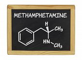 chemical formula of methamphetamine on a blackboard