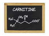 chemical formula of carnitine on a blackboard