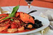 Plate of Seafood Fradiavolo with glass of red wine