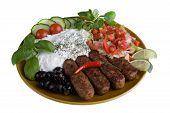 meal with tzatziki, cevapcici and salad