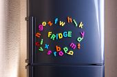 Word Fridge spelled out using colorful magnetic letters on refrigerator