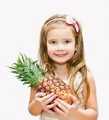 Smiling Cute Little Girl Holding Ripe Whole Pineapple