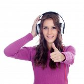Entertaining girl with headphones listening to music isolated on a white background