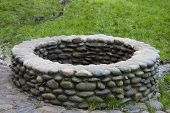 image of water well  - the stones surrounding a water well - JPG