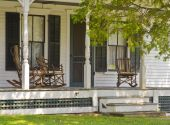 Vintage Vermont front porch with rocking chairs.