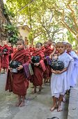 Young Monks Begging For Alms