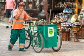 SARAJEVO, BOSNIA AND HERZEGOVINA - AUGUST 13, 2012: waste collector pushes trolley on Bascarsija, th