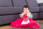 stock photo of hanbok  - Korean baby girl seating on carpet - JPG