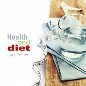 Glass of water and  measuring tape - healh and diet concept - over white (with easy removable sample