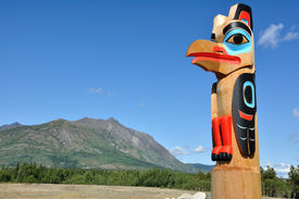 stock photo of tlingit  - Eagle Totem Pole Against a Blue Sky located in Carcross Yukon Canada Copy Space - JPG