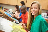 stock photo of 13 year old  - Female Pupil In High School Art Class - JPG