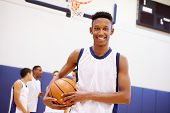 stock photo of 16 year old  - Portrait Of High School Basketball Player - JPG