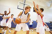 foto of 16 year old  - Male High School Basketball Team Playing Game - JPG