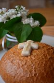 A first communion bread with cross