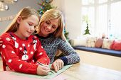 Mother And Daughter Writing Letter To Santa Together