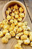 Popcorn Caramel On Board In Wooden Bowl
